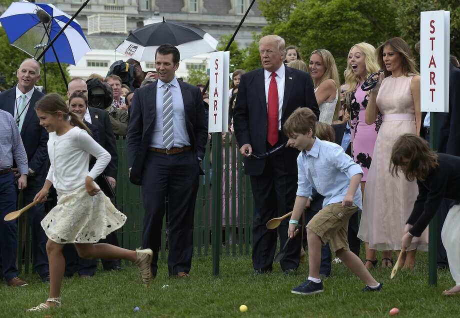 President Trump and first lady Melania Trump watch an Easter Egg Roll race on the South Lawn of the White House. Donald trump Jr., and Tiffany Trump also joined the festivities. Photo: Susan Walsh, Associated Press