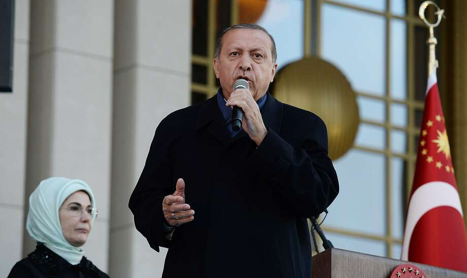 """Turkish President Recep Tayyip Erdogan greets supporters in Ankara. He dismissed criticism of the referendum vote giving him more power, saying the """"debate about this issue is now over."""" Photo: Gokhan Sahin, Getty Images"""