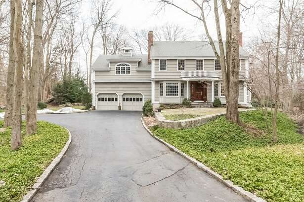 The house at 27 Pheasant Run looks like a typical colonial but inside it has both traditional and contemporary floor plans.