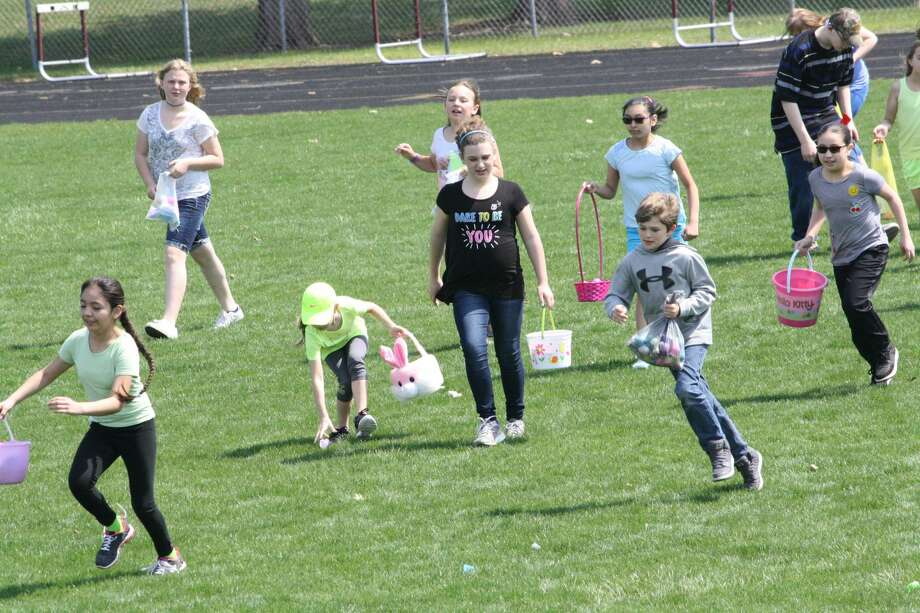 The Cass City Missionary Church sponsored the local egg hunt. It put out about 3,700 eggs for eager children to collect. Photo: Rich Harp/For The Tribune