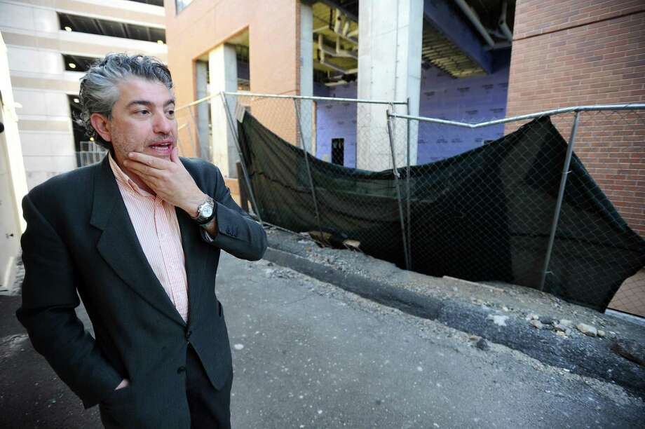 Stefano Staiano, owner of Aria Restaurant at 1033 Washington Blvd., looks at the Park Square West IV construction site that he says is hurting his business with constantly falling debris and poorly maintained fencing. Photographed in Stamford, Conn. on Tuesday, April 11, 2017. Photo: Michael Cummo / Hearst Connecticut Media / Stamford Advocate