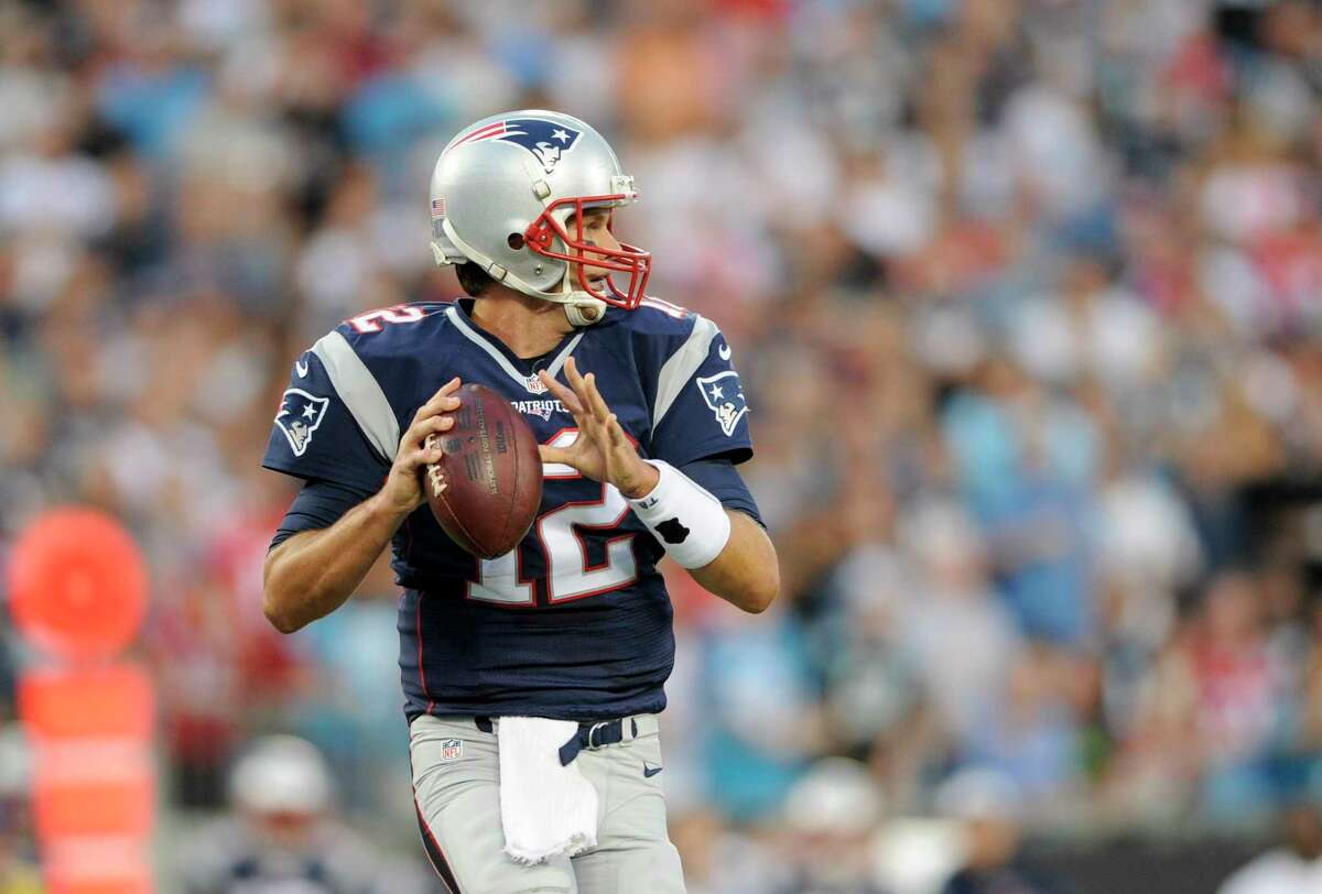 New England Patriots quarterback Tom Brady (12) looks to pass during a pre-season NFL football game against the Carolina Panthers Friday, Aug. 28, 2015 in Charlotte, N.C. (AP Photo/Mike McCarn)