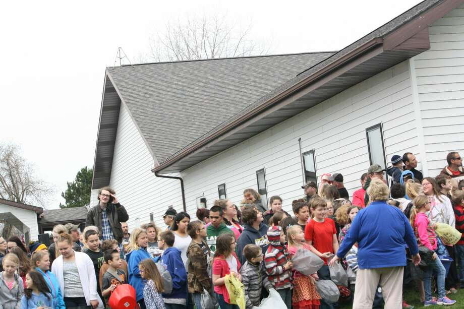 A helicopter Easter egg drop, egg hunts and other festive activities were held at the Community Wesleyan Church and Huron Youth Center in Elkton. Photo: Rich Harp/For The Tribune