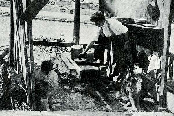 "From the rare ""New San Francisco Magazine,""  published a few months after the 1906 San Francisco earthquake and fire, covered the resurrection of the city. This image is captioned ""The kitchen sink makes a splendid oven in emergencies. It shows a woman, left homeless, making the best of her situation. From the collection of Bob Bragman"