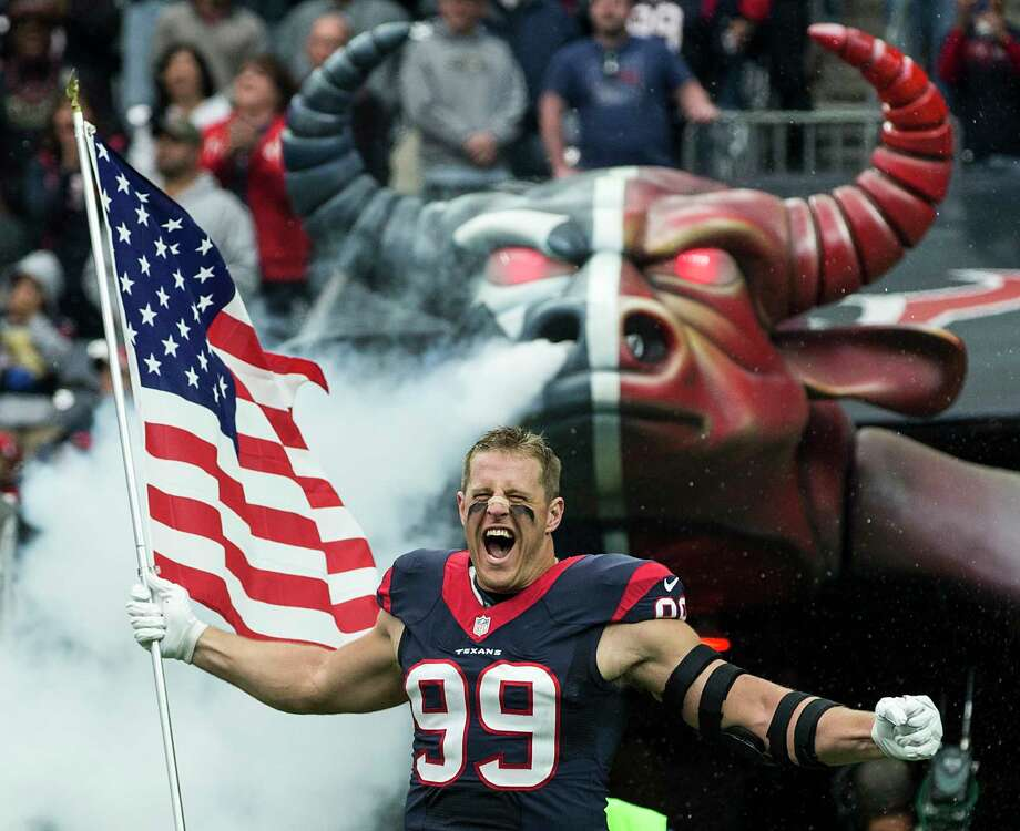 Houston Texans defensive end J.J. Watt carries a flag as he runs onto the field during pre-game ceremonies before an NFL football game between the Texans and the New York Jets at NRG Stadium on Sunday, Nov. 22, 2015, in Houston. ( Brett Coomer / Houston Chronicle ) Photo: Brett Coomer, Staff / © 2015  Houston Chronicle