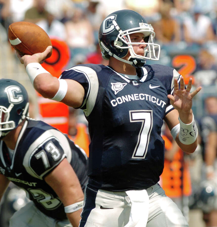FILE -  9/4/04 University of Connecticut's Dan Orlovsky makes a pass during their opening game against Murray St. at Rentschler Field in East Hartford Sept. 4. Photo: File Photo/Andrea Dixon, File Photo / Connecticut Post file photo