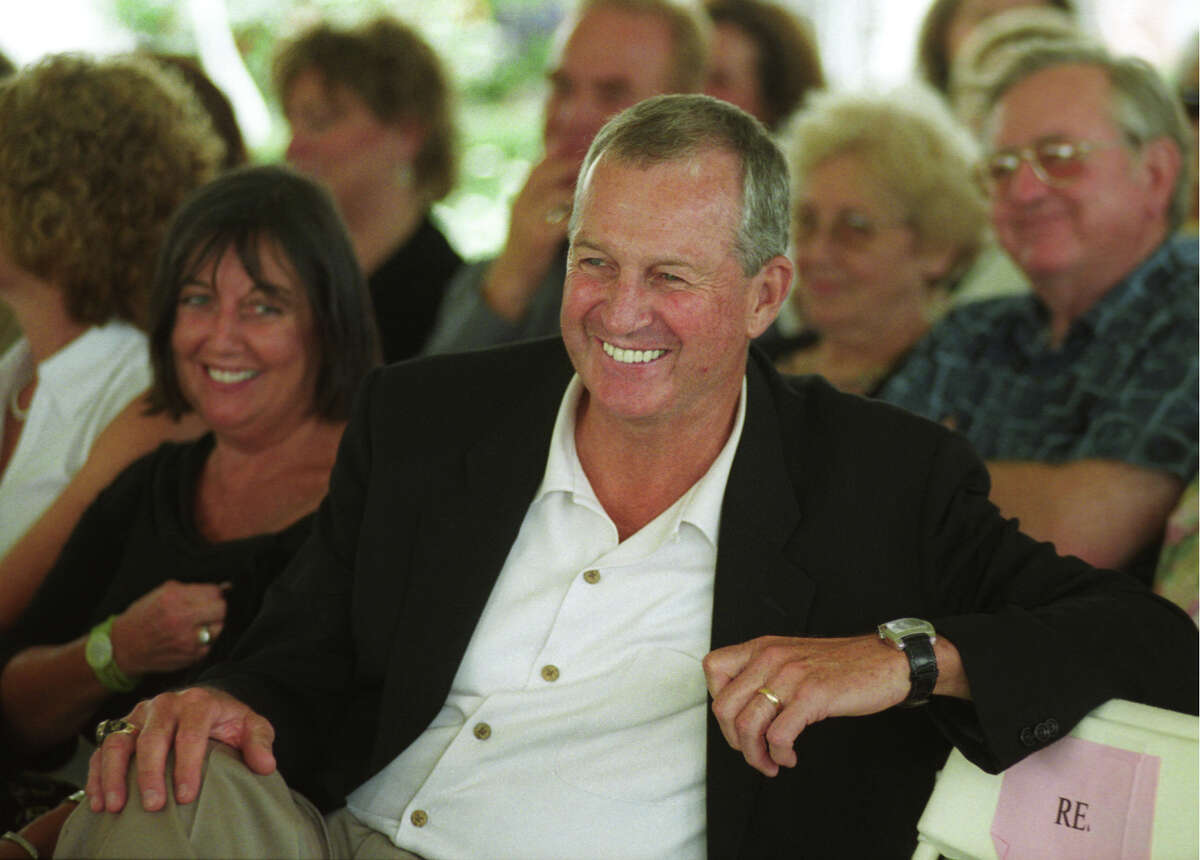 FILE - 7/25/04 UCONN basketball coach Jim Calhoun cracks a smile during his introduction as guest speaker at the Broadway on Beachside fundraiser.