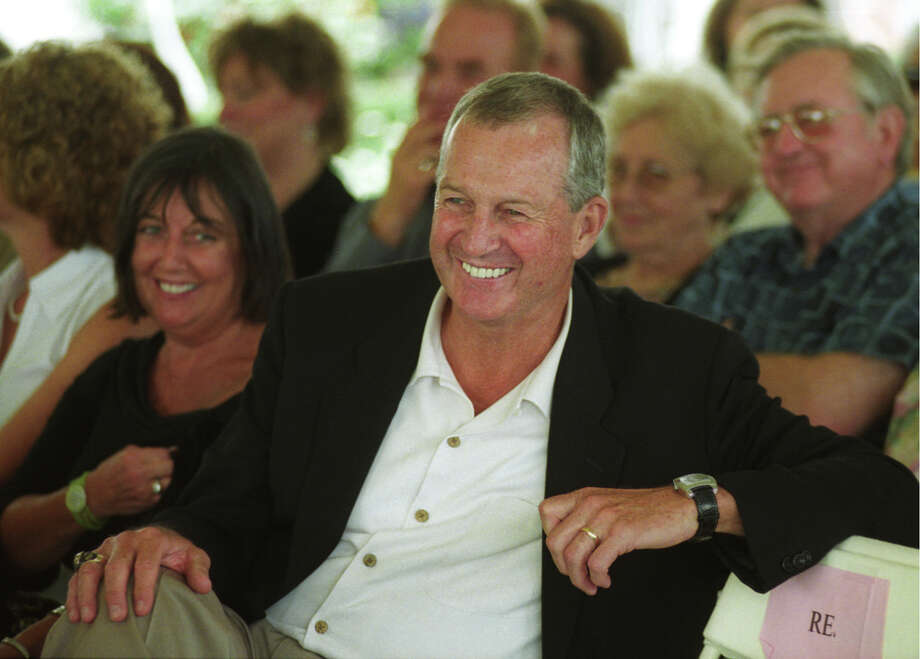 FILE -  7/25/04  UCONN basketball coach Jim Calhoun cracks a smile during his introduction as guest speaker at the Broadway on Beachside fundraiser. Photo: File Photo / Connecticut Post file photo
