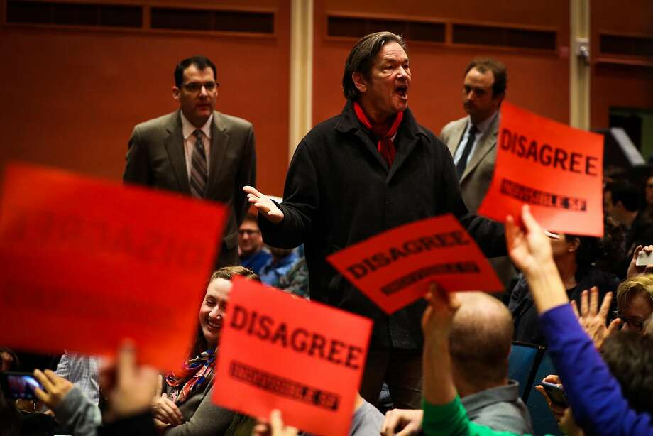 Senator Dianne Feinstein's town hall meeting is interupted by heckler Michael Stone (center) speaking out at the Scottish Rite Masonic Center San Francisco, California, on Monday, April 17, 2017. Photo: Gabrielle Lurie, The Chronicle