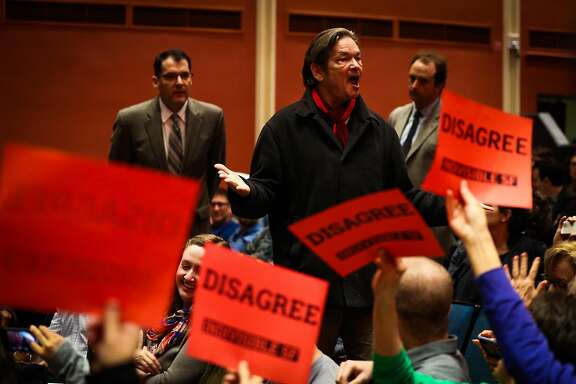 Senator Dianne Feinstein's town hall meeting is interupted by heckler Michael Stone (center) speaking out at the Scottish Rite Masonic Center San Francisco, California, on Monday, April 17, 2017.