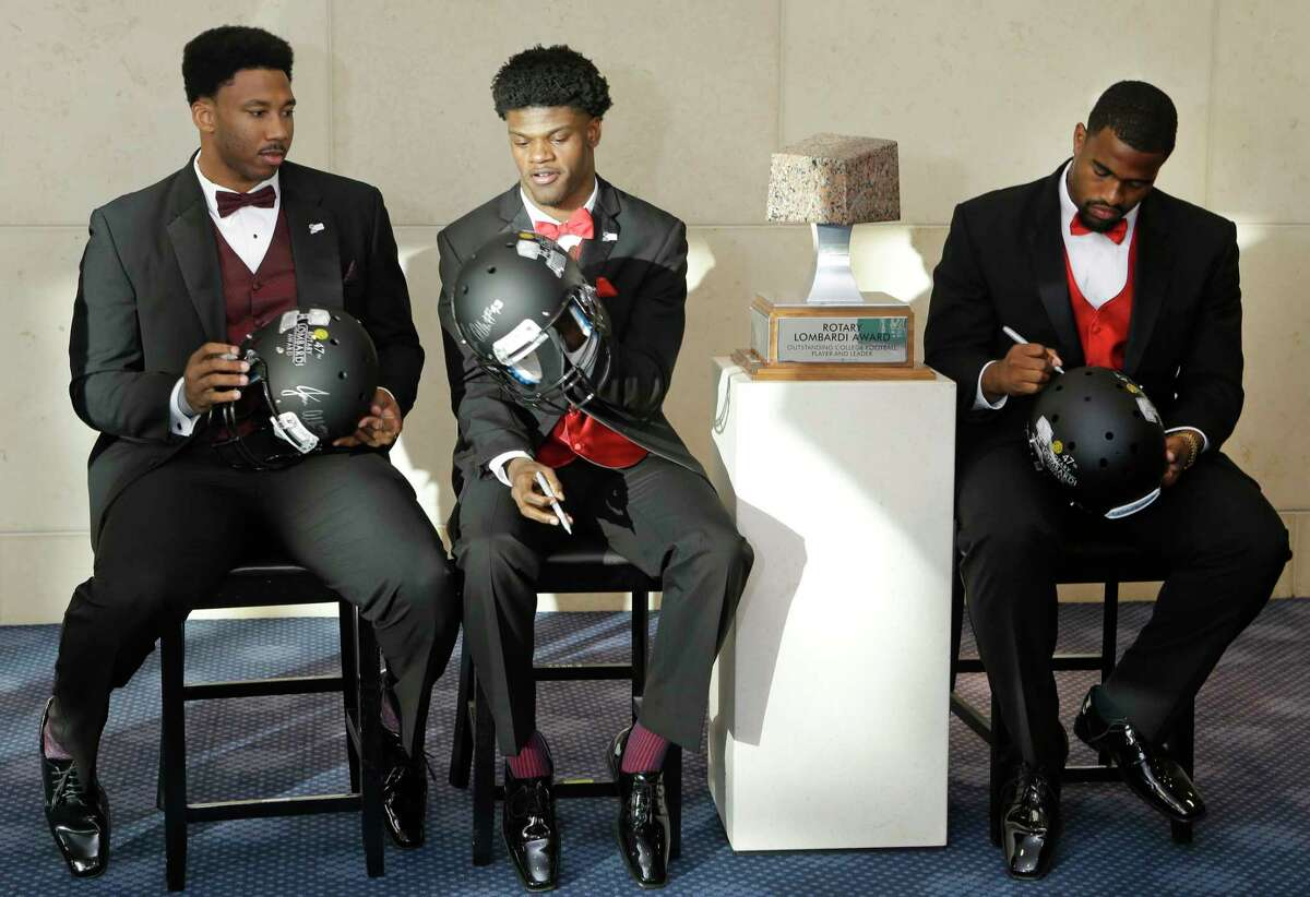 Myles Garrett, left, Texas A&M, Lamar Jackson, University of Louisville, and Jonathan Allen, right, University of Alabama, sign autographs at the Rotary Lombardi Award at the Hobby Center, 800 Bagby, Saturday, Feb. 11, 2017, in Houston. The three players along with Jabrill Peppers University of Michigan, are the Rotary Lombardi Award candidates. Peppers was unable to attend.