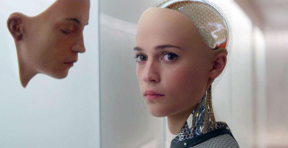 "In this image released by A24 Films, Alicia Vikander appears in a scene from ""Ex Machina."" Vikander was nominated for a Golden Globe award for best supporting actress for her role in the film on Thursday, Dec. 10, 2015. The 73rd Annual Golden Globes will be held on Jan. 10, 2016.  (A24 Films via AP) Photo: Associated Press"