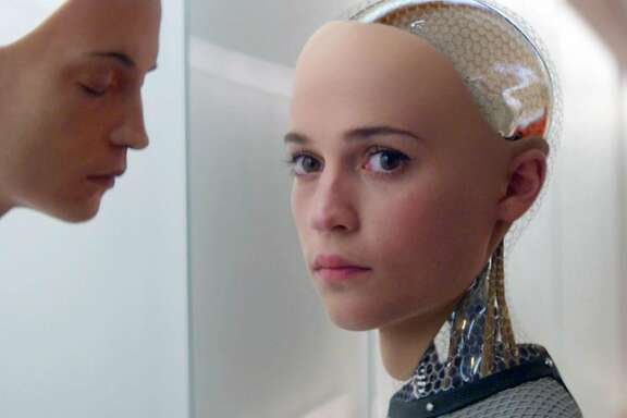 """In this image released by A24 Films, Alicia Vikander appears in a scene from """"Ex Machina."""" Vikander was nominated for a Golden Globe award for best supporting actress for her role in the film on Thursday, Dec. 10, 2015. The 73rd Annual Golden Globes will be held on Jan. 10, 2016.  (A24 Films via AP)"""