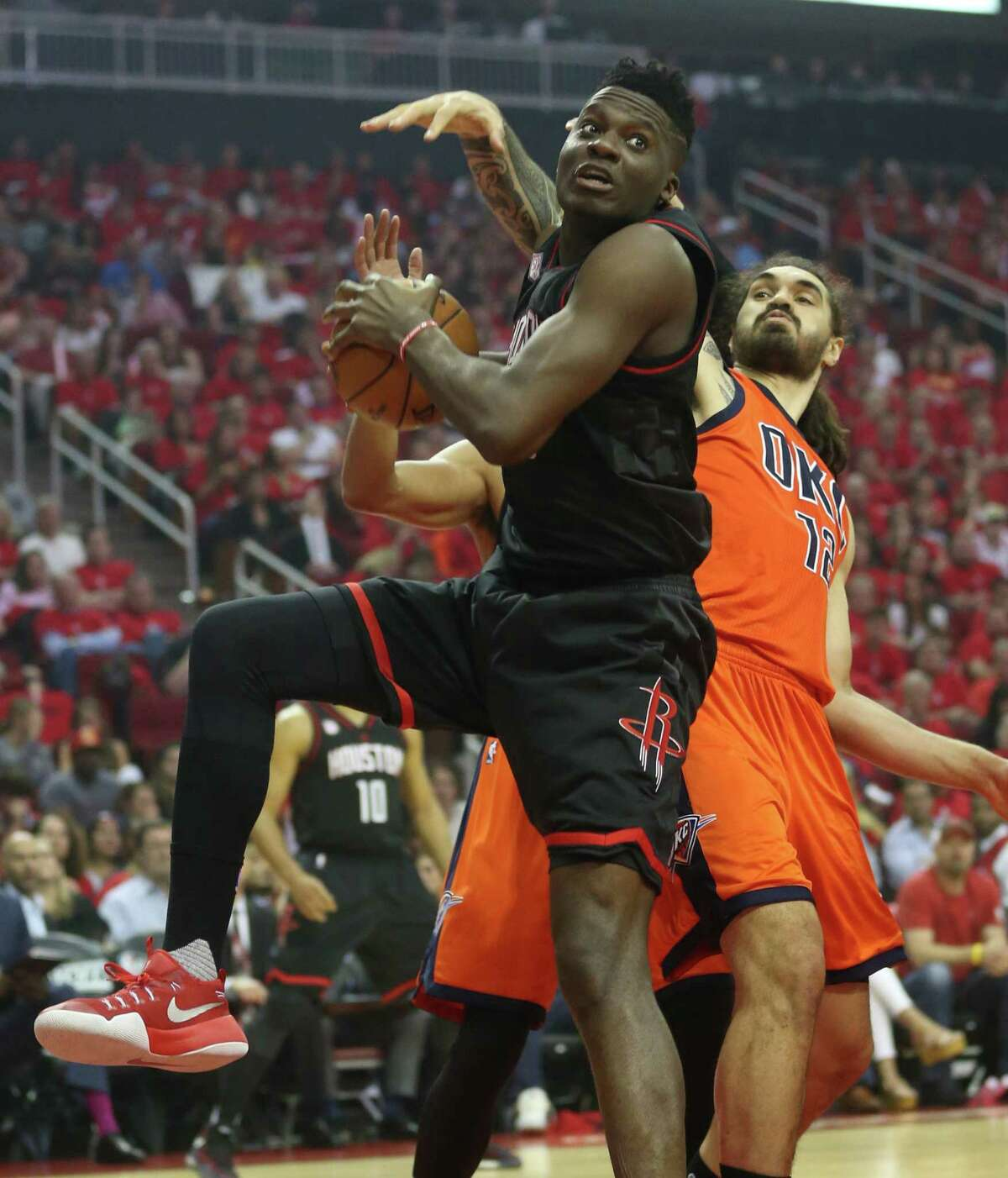 Houston Rockets center Clint Capela (15) gras a rebound against Oklahoma City Thunder center Steven Adams (12) during the first half of Game 1 of an NBA basketball first-round, Western Conference playoffs at the Toyota Center, Sunday April 16, 2017, in Houston. ( Karen Warren / Houston Chronicle )