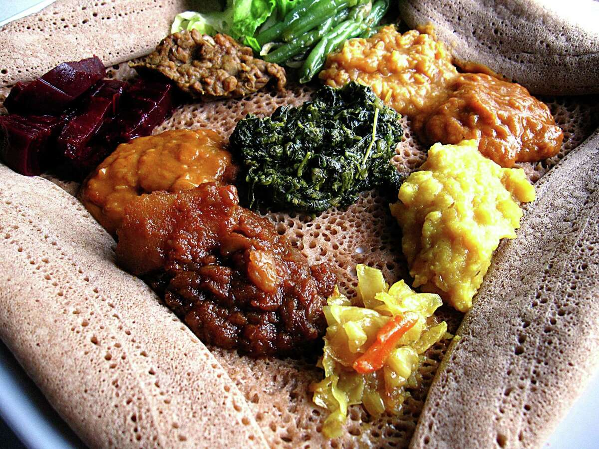 A sampler of vegetarian sides, served on injera bread at Rehoboth Eritrean-Ethiopian Cuisine.