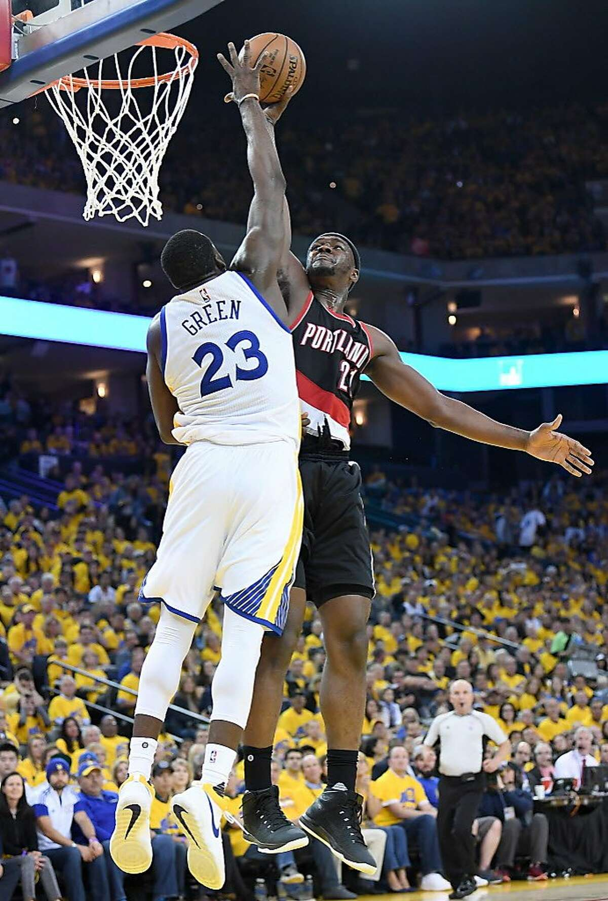 OAKLAND, CA - APRIL 16: Draymond Green #23 of the Golden State Warriors blocks the shot of Noah Vonleh #21 of the Portland Trail Blazers in the third quarter during Game One of the first round of the 2017 NBA Playoffs at ORACLE Arena on April 16, 2017 in Oakland, California. NOTE TO USER: User expressly acknowledges and agrees that, by downloading and or using this photograph, User is consenting to the terms and conditions of the Getty Images License Agreement. (Photo by Thearon W. Henderson/Getty Images)