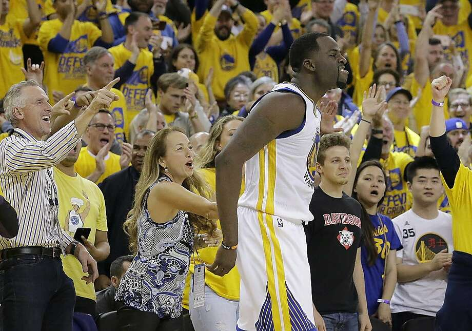 Golden State Warriors forward Draymond Green (23) celebrates in front of fans during the second half of Game 1 of a first-round NBA basketball playoff series against the Portland Trail Blazers in Oakland, Calif., Sunday, April 16, 2017. The Warriors won 121-109. (AP Photo/Jeff Chiu) Photo: Jeff Chiu, Associated Press
