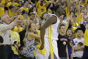 Golden State Warriors forward Draymond Green (23) celebrates in front of fans during the second half of Game 1 of a first-round NBA basketball playoff series against the Portland Trail Blazers in Oakland, Calif., Sunday, April 16, 2017. The Warriors won 121-109. (AP Photo/Jeff Chiu)