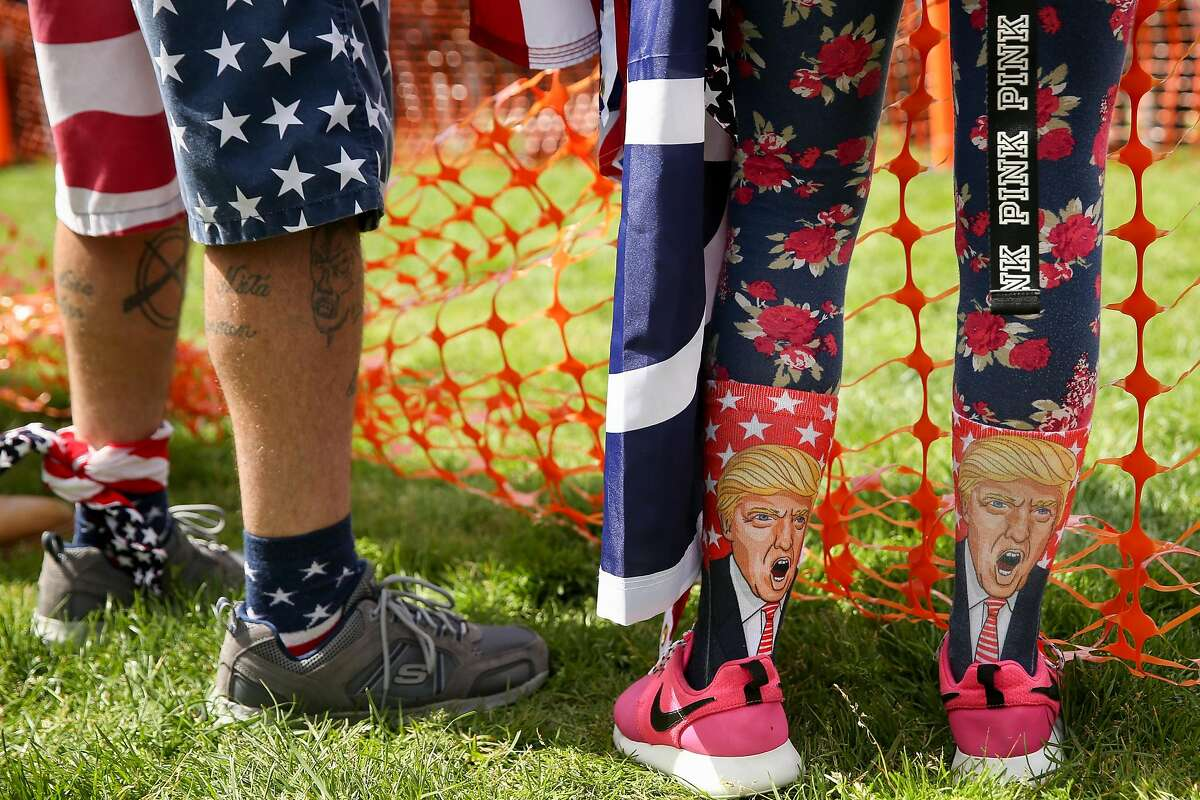 """BERKELEY, CA - APRIL 15: A Trump supporter sports Trump socks at a """"Patriots Day"""" free speech rally on April 15, 2017 in Berkeley, California. More than a dozen people were arrested after fistfights broke out at a park where supporters and opponents of President Trump had gathered. (Photo by Elijah Nouvelage/Getty Images)"""