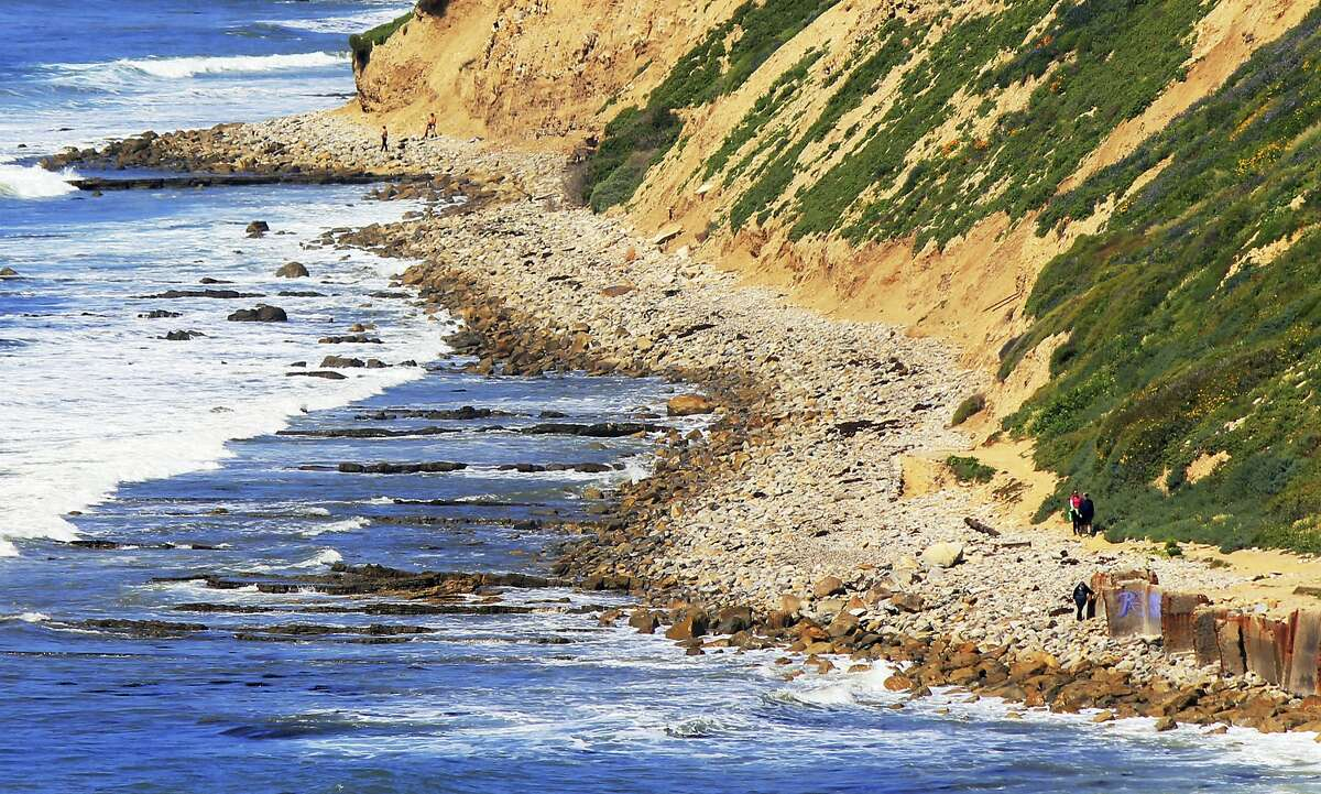 Waves roll onto boulders at the foot of a sea cliff near Royal Palms Beach in the San Pedro area of Los Angeles. A new study predicts that with limited human intervention, 31 percent to 67 percent of Southern California beaches could completely erode back to coastal infrastructure or sea cliffs by the year 2100, with sea-level rises of 3.3 feet (1 meter) to 6.5 feet (2 meters). The study released Monday, March 27, 2017, used a new computer model to predict shoreline effects caused by sea level rise and changes in storm patterns due to climate change.