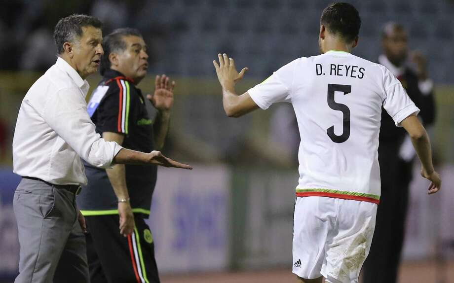 Mexico's Diego Reyes (5) celebrates with coach Juan Carlos Osorio after scoring his team's first goal against Trinidad and Tobago in a 2018 World Cup qualifying soccer match in Port of Spain, Trinidad and Tobago, Tuesday, March 28, 2017.(AP Photo/Fernando Llano) Photo: Fernando Llano, STF / Associated Press / Copyright 2017 The Associated Press. All rights reserved.