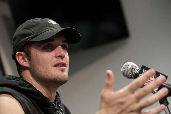 Derek Carr answers a question from a reporter as several Oakland Raiders spoke to the press following their first off-season workouts at the Raiders facility in Alameda, Calif., on Monday, April 17, 2017.