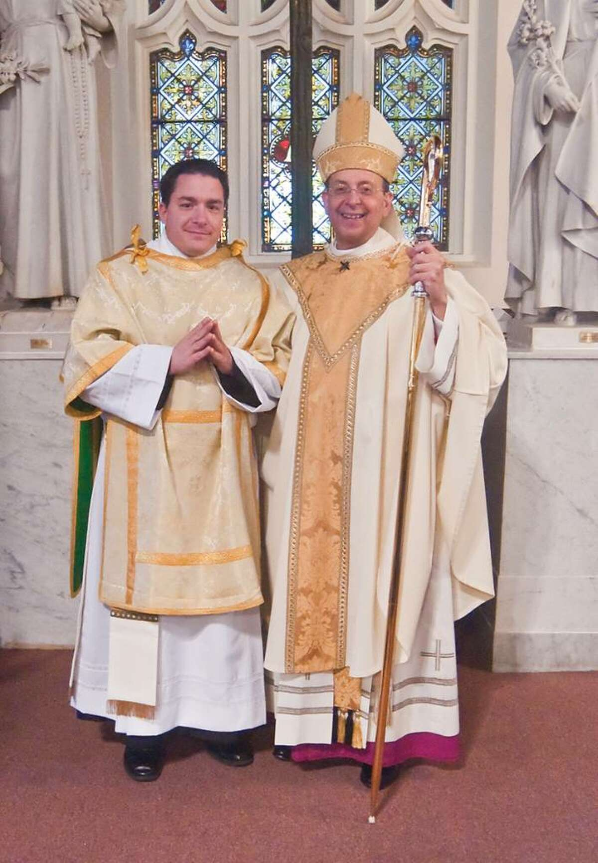 Jeff Couture, 38, of Fairfield, left, with Bishop Lori last June at Couture's ordination as a deacon. Couture will be ordained as a priest in the Bridgeport Diocese on Saturday during a ceremony at St. Augustine Cathedral in Bridgeport. (Karen Leffler Photography)