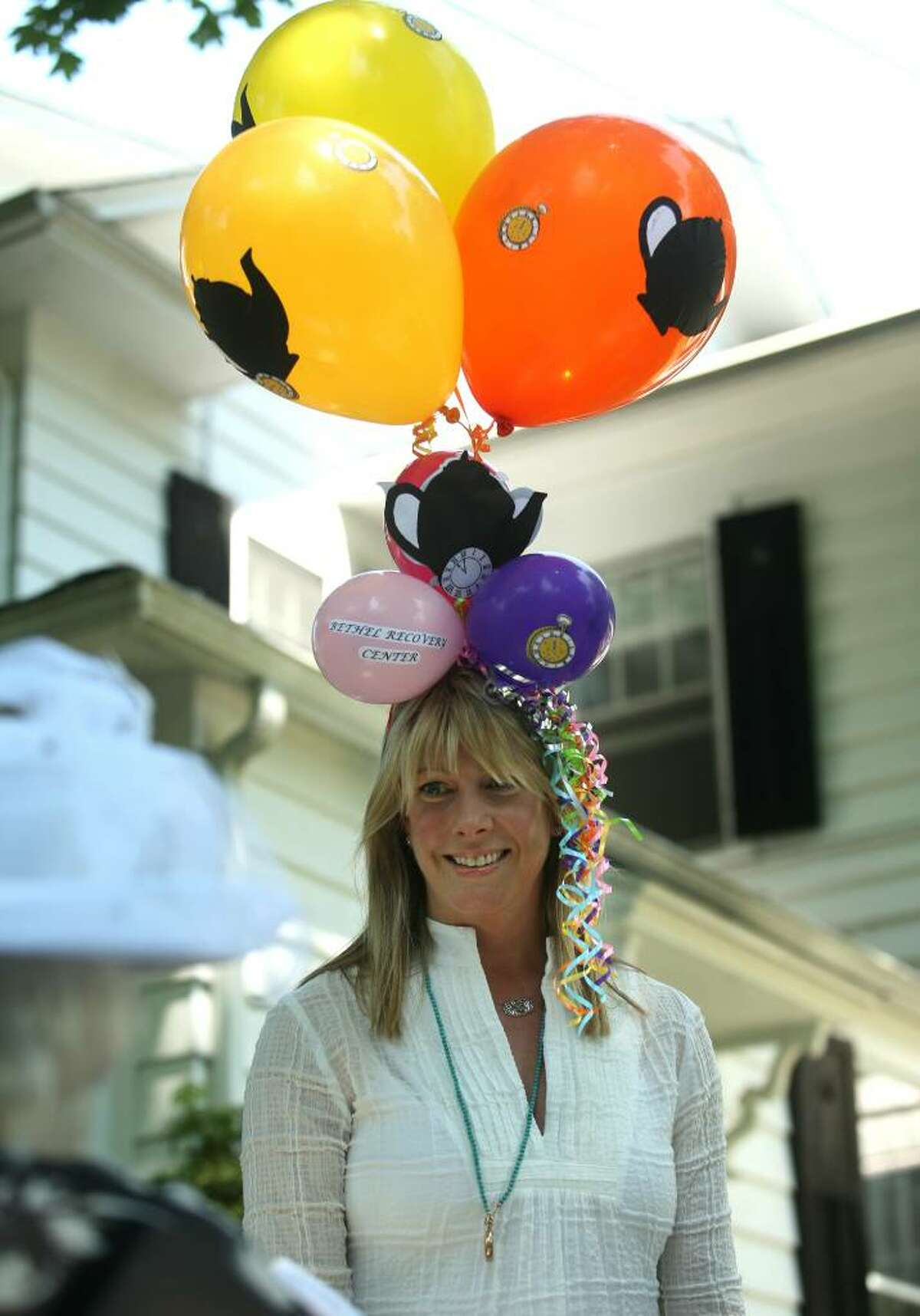 Kelley Schutte fashioned a creative balloon hat for the eighth annual Mad Hatter's Tea Party fundraiser for the Bethel Recovery Center on Tuesday, May 25, 2010.