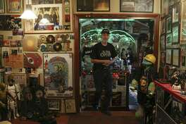 Michael Thompson, 66, shows off his house full of rock and roll memorabilia near Medina Lake. Thompson has been collecting since 1967.