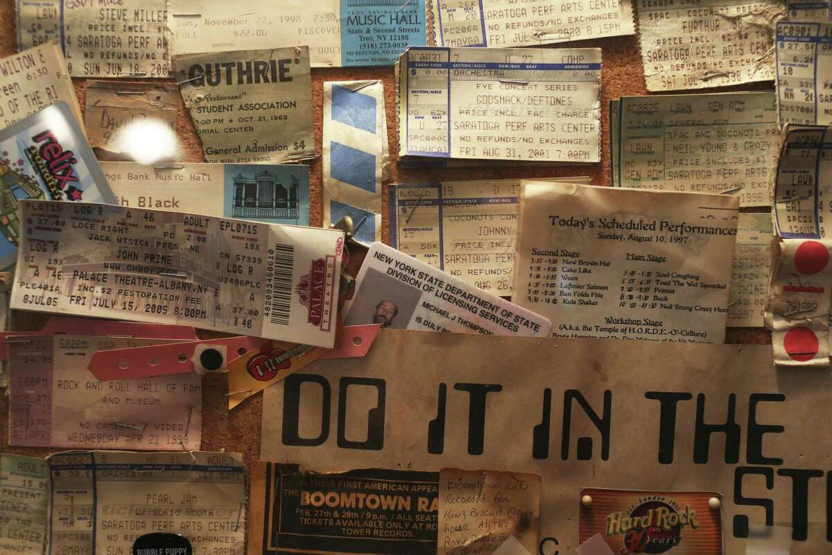 A frame full of concert ticket stubs adorns the entrance to the house of Michael Thompson, near Medina Lake.