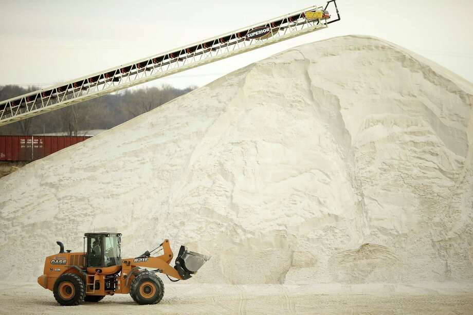 A load of sand is transported from the pile at rear to the Jordan Sands processing plant nearby where it will be washed, dried, and sifted on April 6, 2015 in Mankato, Minn. Photo: Jeff Wheeler /Minneapolis Star Tribune