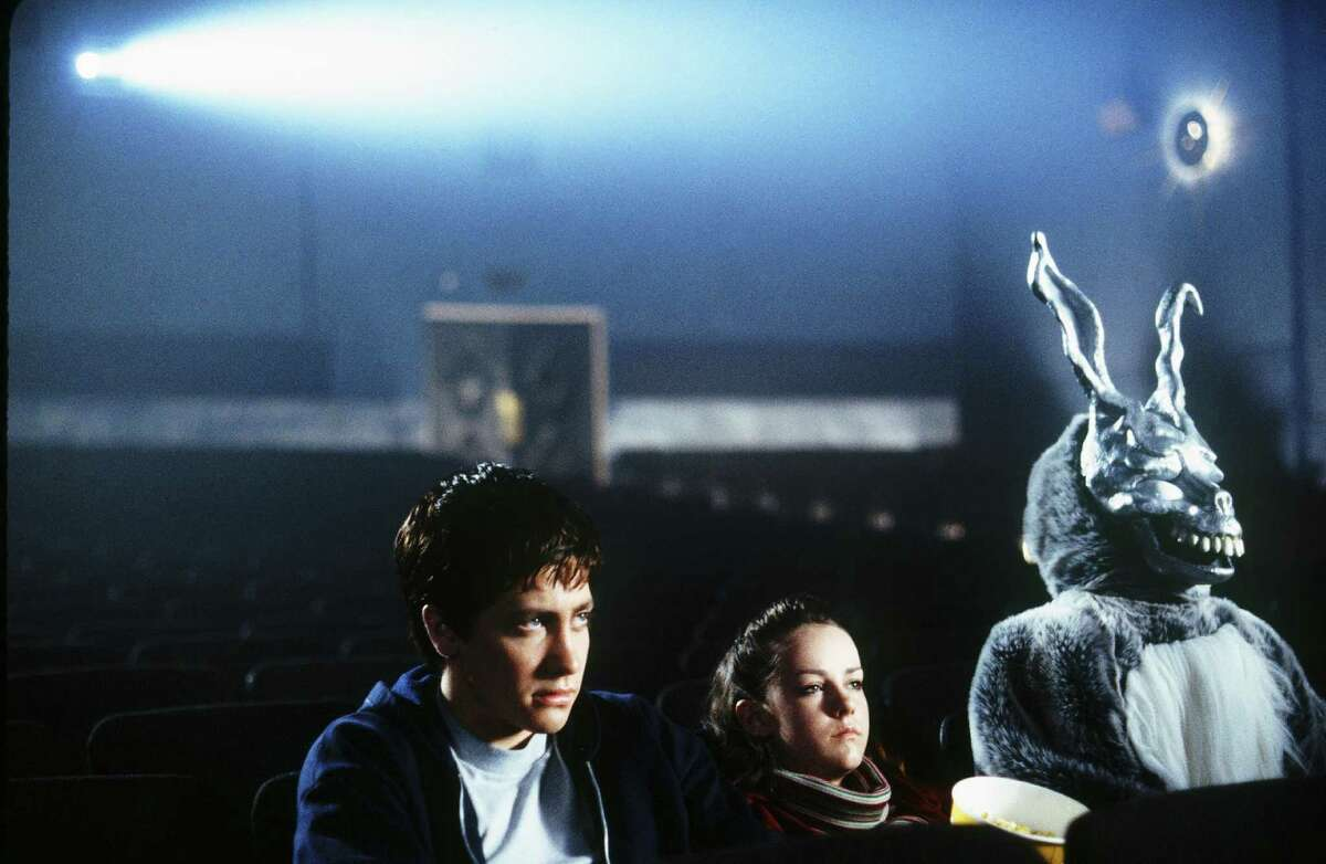 It's an empty theater. The bunny could have sat anywhere. Jake Gyllenhaal, Jena Malone and friend in Richard Kelly's 2001 cult classic