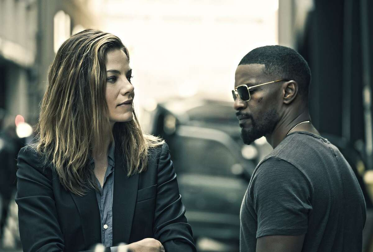 Jamie Foxx cops an attitude with fellow cop Michelle Monaghan in