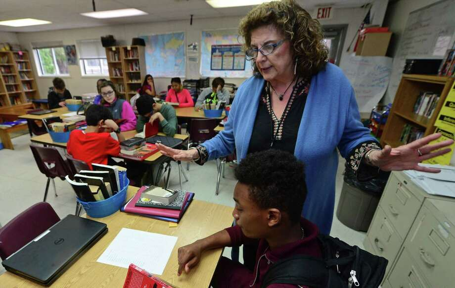 One of Side by Side Charter School founding teachers, Carole Oddie, teaches her eighth-grade Humanities class at the school in Norwalk. The school is celebrating its 20th anniversary and has announced construction plans for a new middle school building. Photo: Erik Trautmann / Hearst Connecticut Media / Norwalk Hour