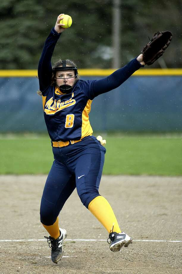 Midland's Maya Kipfmiller pitches to a Heritage during the first inning on Monday at Midland High School. The Chemics won the first game of the double-header 10-0 in five innings. Photo: NICK KING | Nking@mdn.net