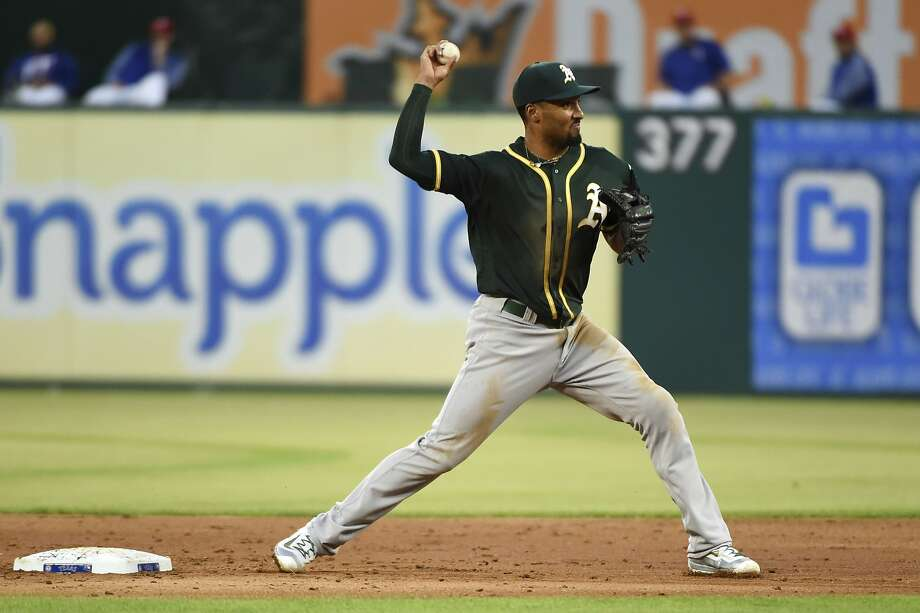Oakland Athletics shortstop Marcus Semien turns a double play against the Texas Rangers in the second inning of a baseball game, Saturday, April 8, 2017, in Arlington, Texas. (AP Photo/Jeffrey McWhorter) Photo: Jeffrey McWhorter, Associated Press
