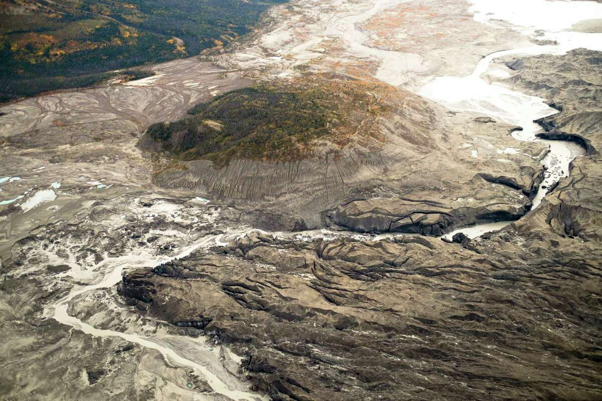 In a handout photo, an aerial view of the ice canyon that now carries meltwater from the Kaskawulsh Glacier away from the Slims River and toward the Kaskawulsh River. In the blink of a geological eye, climate change has helped reverse the flow of water melting from the glacier in CanadaÂ?'s Yukon, a hijacking that scientists call Â?