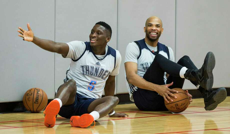 Oklahoma City Thunder guard Victor Oladipo (5) and forward Taj Gibson (22) laugh as they take a seat on the floor following practice at the University of Houston on Monday, April 17, 2017, in Houston. The Thunder play the Houston Rockets in Game 2 of first round of the NBA Western Conference Playoffs on Wednesday at Toyota Center.  ( Brett Coomer / Houston Chronicle ) Photo: Brett Coomer, Staff / © 2017 Houston Chronicle