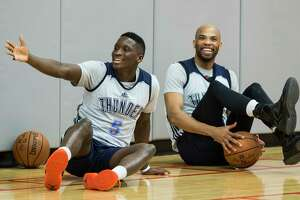 Oklahoma City Thunder guard Victor Oladipo (5) and forward Taj Gibson (22) laugh as they take a seat on the floor following practice at the University of Houston on Monday, April 17, 2017, in Houston. The Thunder play the Houston Rockets in Game 2 of first round of the NBA Western Conference Playoffs on Wednesday at Toyota Center.  ( Brett Coomer / Houston Chronicle )