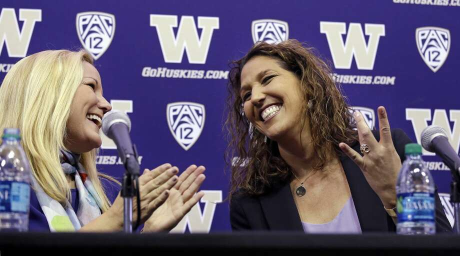 "New Washington head coach Jody Wynn, right, creates a ""W"" with her fingers, symbolizing the school name, as she shares a laugh with athletic director Jennifer Cohen at the end of a news conference introducing her Monday, April 17, 2017, in Seattle. Wynn comes to Washington from Long Beach State, where she was head coach for eight seasons. (AP Photo/Elaine Thompson) Photo: Elaine Thompson/AP"
