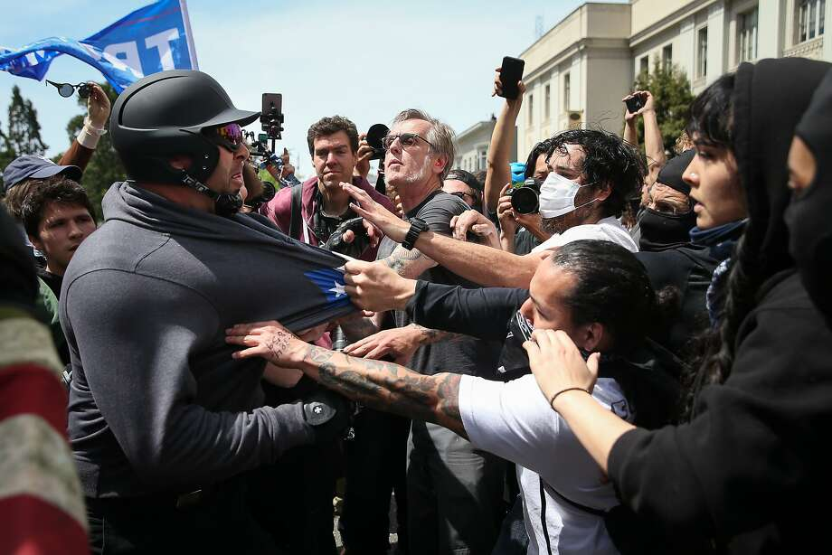 "Trump supporter, Kyle Chapman, left, clashes with protesters at a ""Patriots Day"" free speech rally on April 15, 2017 in Berkeley, California. More than a dozen people were arrested after fistfights broke out at a park where supporters and opponents of President Trump had gathered. Photo: Elijah Nouvelage, Getty Images"