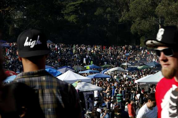 People pack Hippie Hill during 420 celebrations in Golden Gate Park in San Francisco, Calif., on Sunday, April 20, 2014.