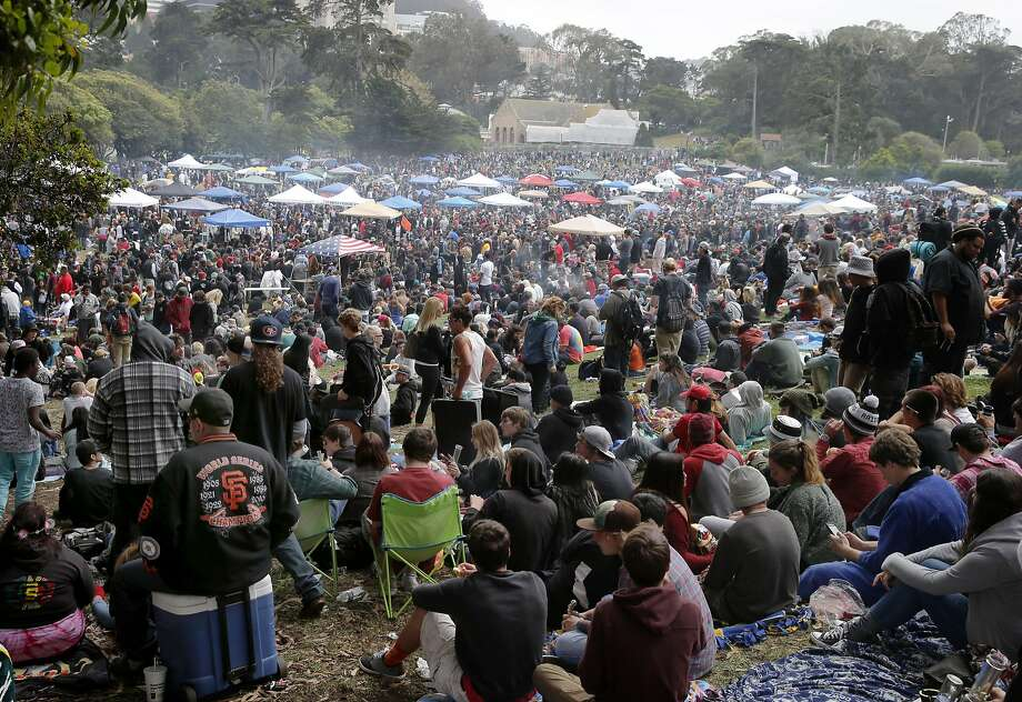 People gathered in the meadow on an overcast afternoon. The annual four twenty celebration of marijuana smoking was attended by thousands near Hippie Hill in Golden Gate Park. Photo: Brant Ward, The Chronicle