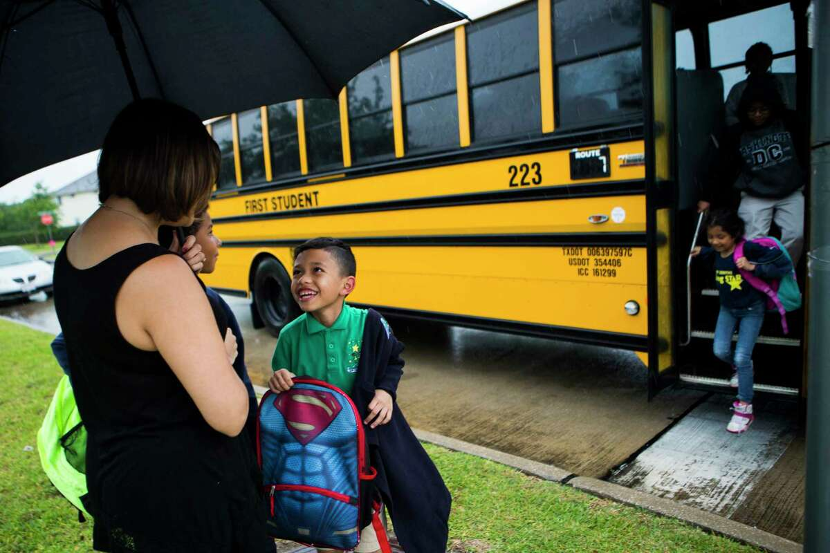 Walter Escobar, 7, runs to his mother Rose Marie Escobar, 31, at the corner where he is dropped by the school bus, Tuesday, April 11, 2017, in Pearland. His father Jose Escobar used to be the parent that would pick him up from school everyday, but that was before he was deported to El Salvador.