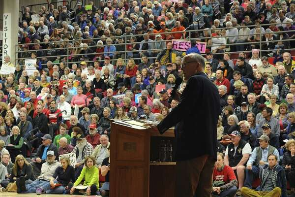 The health care President Trump proposes would hurt the same people who voted for him. Here, Rep. Greg Walden answers questions from a crowd during a town hall in Bend, Ore., Thursday. Walden, who is a leading author of the mired Republican health care bill, said he's skeptical about proposals the Trump administration and conservative GOP lawmakers have discussed in hopes of breathing life into the legislation.