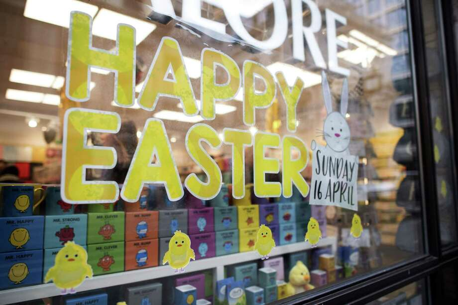 "A Happy Easter sign is displayed in the window of a card shop in London. British Prime Minister Theresa May waded into the controversy erupting after the confectionary giant Cadbury decided to omit the word ""Easter"" from the title of an annual egg hunt it sponsors, calling the event ""Cadbury's Great British Egg Hunt."" A reader weighs in on the discussion. Photo: JUSTIN TALLIS /AFP /Getty Images / AFP or licensors"