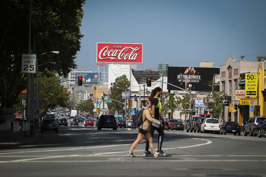 A giant Coca-Cola billboard along Interstate 80 near the Bay Bridge in San Francisco, California, is seen on Saturday, June 13, 2015. The beverage industry has taken San Francisco to court over a law requiring that soda advertisements carry a warning label. Exempted are the pictured sign and the Giants' world-famous Coke bottle slide at AT&T Park. Photo: Loren Elliott, The Chronicle