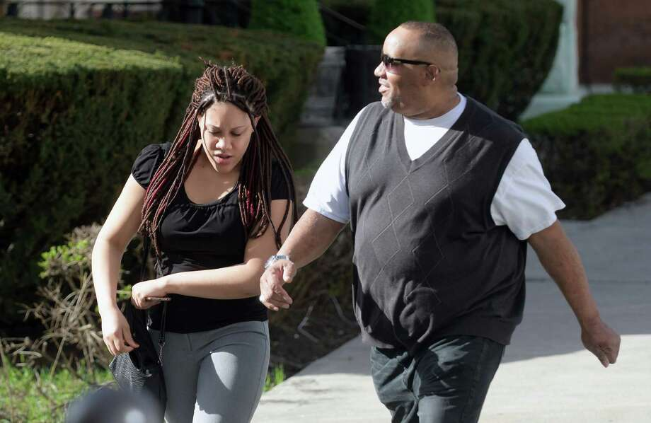 Ariel Agudio, left, makes her way into Albany County Court on Monday, April 17, 2017, in Albany, N.Y.  Jury selection began in Agudio's trial on Monday.  She is accused of fabricating a racially charged attack on a CDTA bus last year.  (Paul Buckowski / Times Union) Photo: PAUL BUCKOWSKI / 20040279A