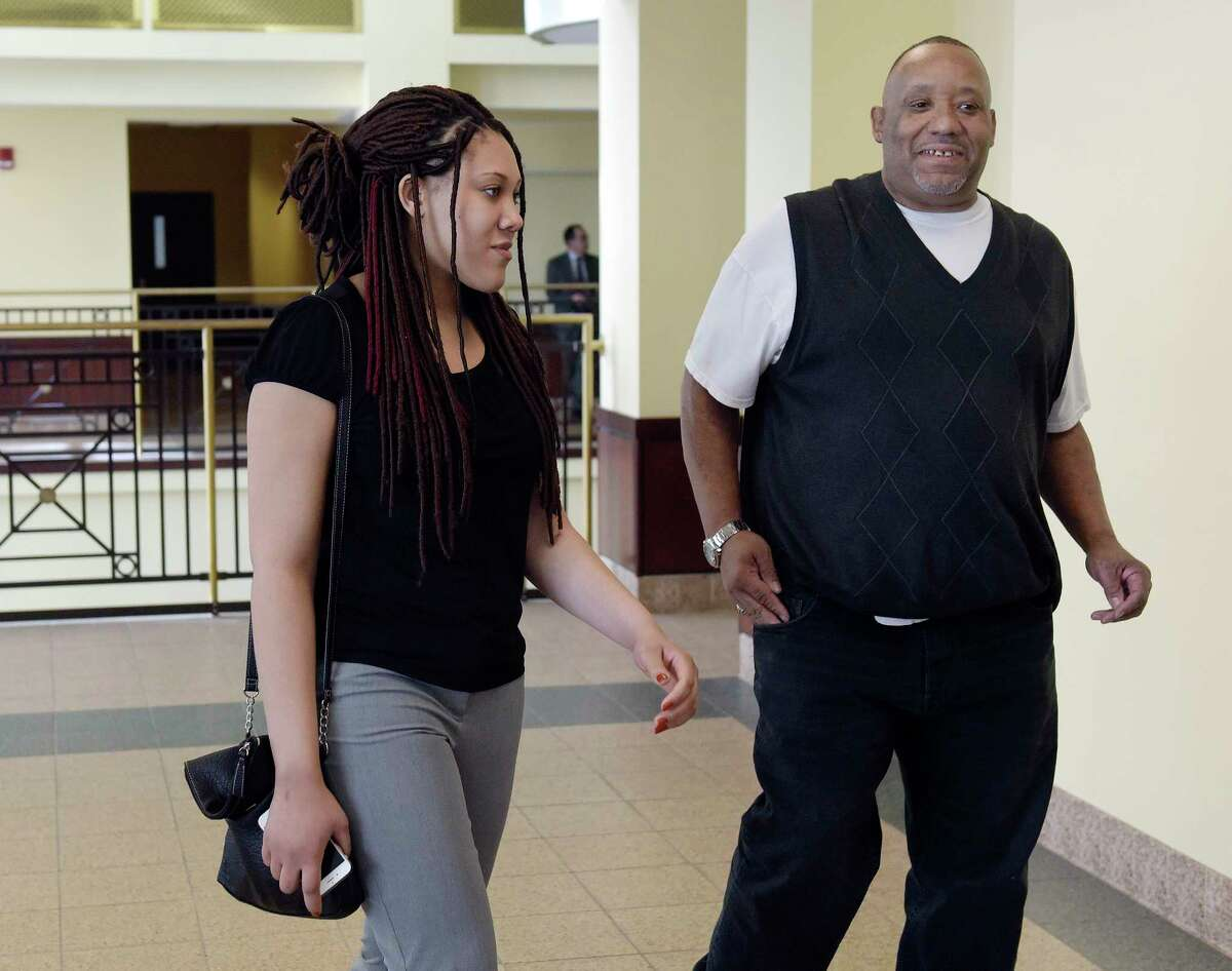 Ariel Agudio, left, makes her way into Albany County Court on Monday, April 17, 2017, in Albany, N.Y. Jury selection began in Agudio's trial on Monday. She is accused of fabricating a racially charged attack on a CDTA bus last year. (Paul Buckowski / Times Union)