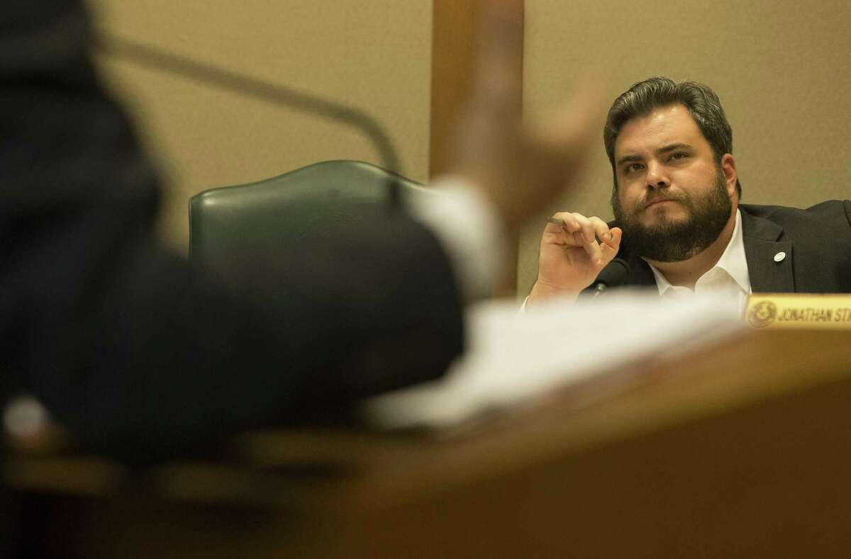 Rep. Jonathan Stickland listens to Rep. Diego Bernal present his House Bill 192.